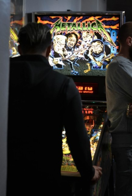 A boy playing on an arcade game