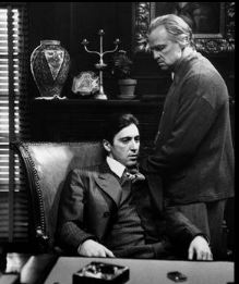 a scene from the Godfather depicting Vito Corleone and Michael Corleone